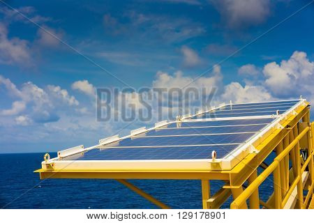 Solar cells install at gas vent boom at remote wellhead platform at the gulf of Thailand background is blue sky and cloudy