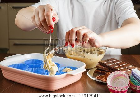 Woman Hands Cast Dough For Muffins.