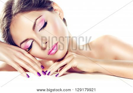 Beautiful girl model demonstrates pure beauty . Well-groomed ,clean skin, purple n manicure and the nails