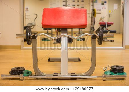 Barbell with elbow support in gym room for weight training muscle building