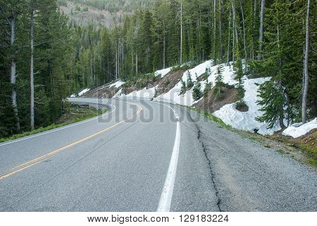 Snow on the roadside in Yellowstone National Park is not melts even in the summer