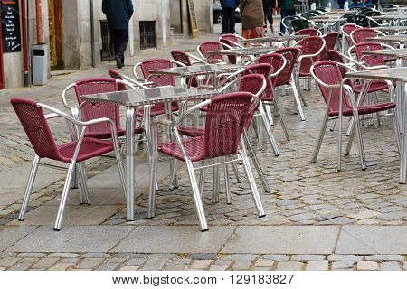 Outdoor restaurant tables and chairs in Spain