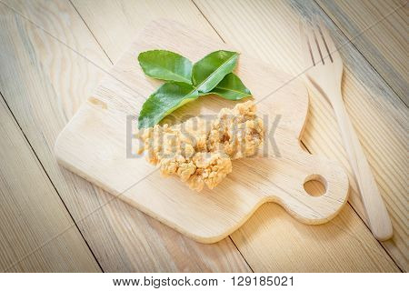 fried chicken in batter on a wooden background.