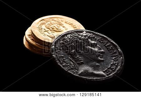 Ancient silver an golden coins isolated on black selective focus macro