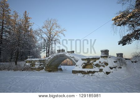 View of Humpback bridge in the january twilight. Gatchina Palace Park, Russia