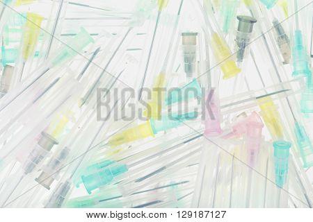 Heap of syringe needles on the white background.