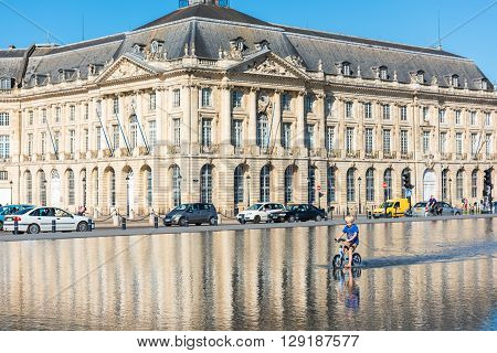 Children Having Fun In A Mirror Fountain In Bordeaux