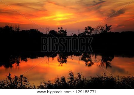 beautiful sunset over the lake - copy space
