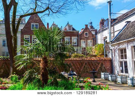 Utrecht Netherlands - April 20 2016: Floras yard with unidentified people. Floras yard is a small park in the old town of Utrecht that becomes provided by enthusiastic volunteers