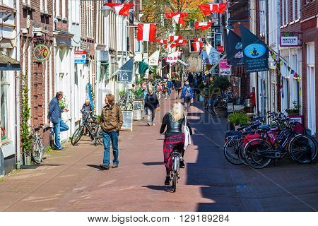 Gouda Netherlands - April 20 2016: street view in Gouda with unidentified people. Gouda is world famous for its cheese that becomes trade here.