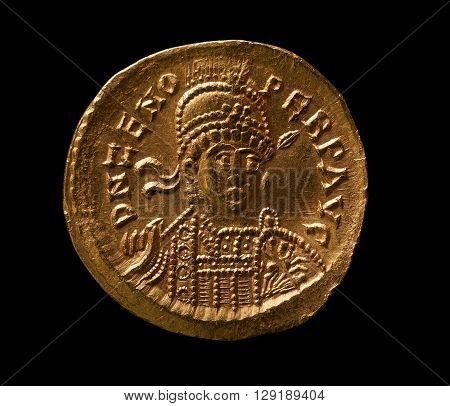Ancient gold Byzantine coin of emperor Zenon close-up macro shot