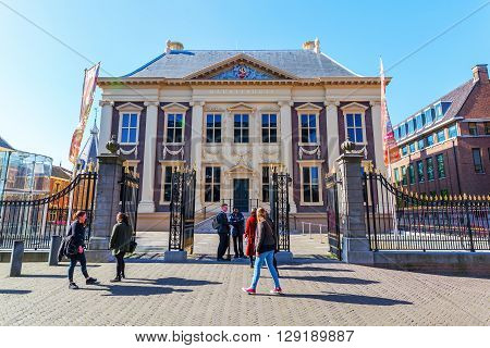 The Hague Netherlands - April 21 2016: Mauritshuis in The Hague with unidentified people. It is an art museum that houses the Royal Cabinet of Paintings with mostly Dutch Golden Age paintings