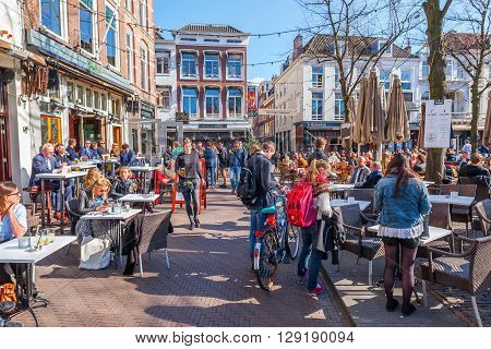 The Hague Netherlands - April 20 2016: town square Het Plein with unidentified people. As a town square Het Plein was constructed in 1632 and was inspired by the Place des Vosges in Paris