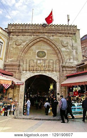 ISTANBUL, TURKEY - MARCH 08, 2008: Tourists in front of the grand bazaar. It is one of the oldest shopping malls in history with over 1200 jewelry carpet leather spice and souvenir shops