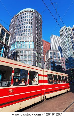 The Hague Netherlands - April 20 2016: old tram with unidentified people in The Hague. The Hague is seat of the Dutch government and the 3rd largest city of the Netherlands with 515880 inhabitants