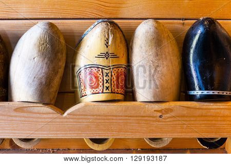 Old used dutch traditional wooden shoes or clogs in Holland