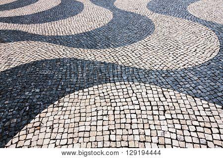 Typical Cobblestone Hand-made Pavement Iin Lisbon, Portugal