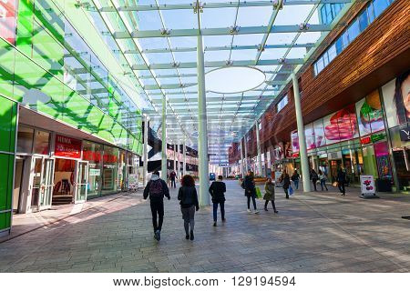 Almere Netherlands - April 19 2016: ceiled pedestrian area with unidentified people in Almere that is a fast planned city. With a population of about 200000 it is the 7th largest Dutch city