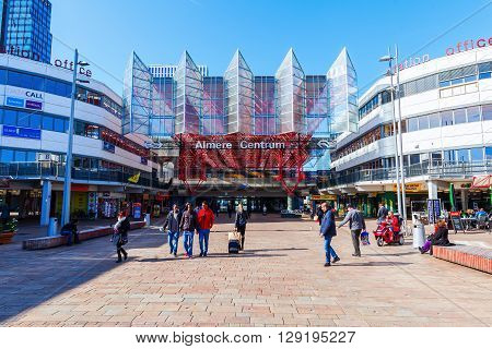 Almere Netherlands - April 20 2016: railway station of Almere with unidentified people. Almere is a fast growing planned city. With a population of about 200000 it is the 7th largest Dutch city