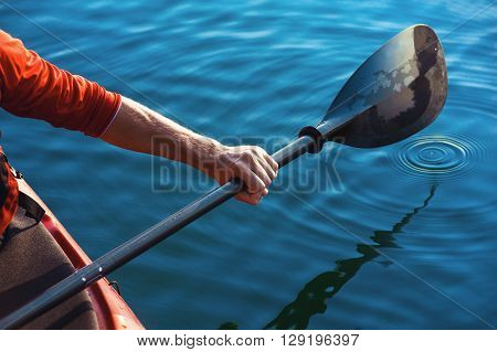 Man's Hand With A Paddle Kayak