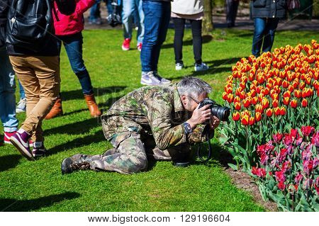 Lisse Netherlands - April 23 2016: Keukenhof with unidentified people. It is one of the worlds largest flower gardens. Approximately 7 million flower bulbs are planted annually in the park
