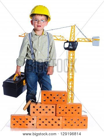 Little boy builder with helmet and tools. Isolated on the white background.