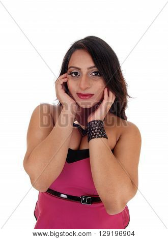 A closeup image of a East Indian woman with her hands on her head dark brown hair isolated for white background.