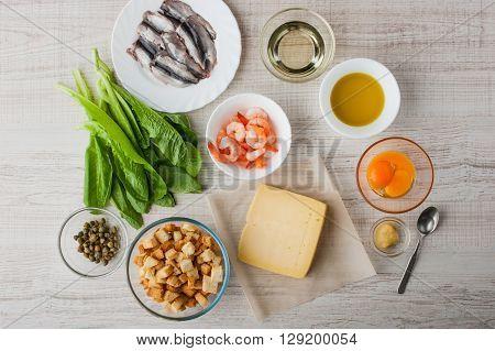 Ingredients for Caesar salad with shrimp and parmesan horizontal