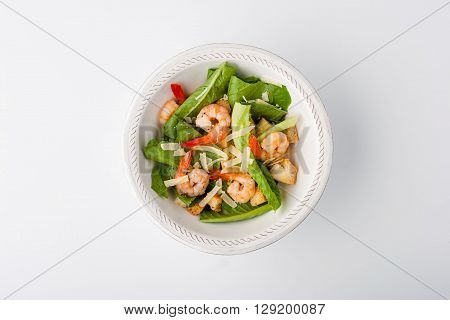 Caesar salad with shrimp parmesan and croutons horizontal