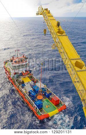 Crane platform loading cargo to supply boat