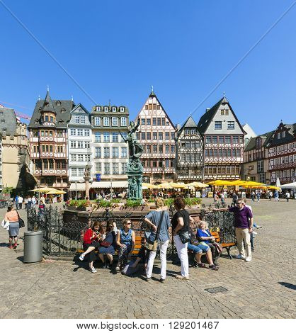 People Visit Romerberg (romerplatz) With Old Buildings  In Frankfurt