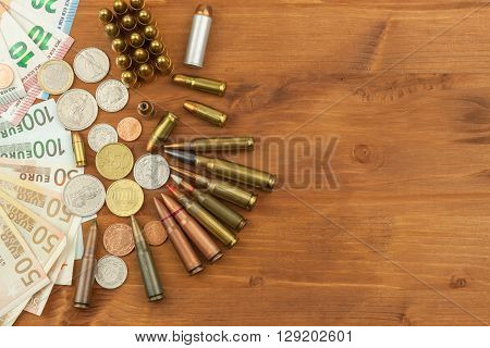 Grocery ammunition, weapons and ammunition sales. Valid euro banknotes and coins. Different types of ammunition. Preparing for war.