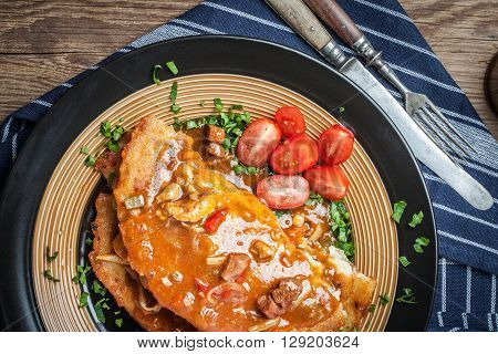 Potato pancakes with meat vegetable tomato and parsley. Selective focus.