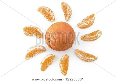 Fresh ripe organic oranges arranged in the form of the sun isolated on white background