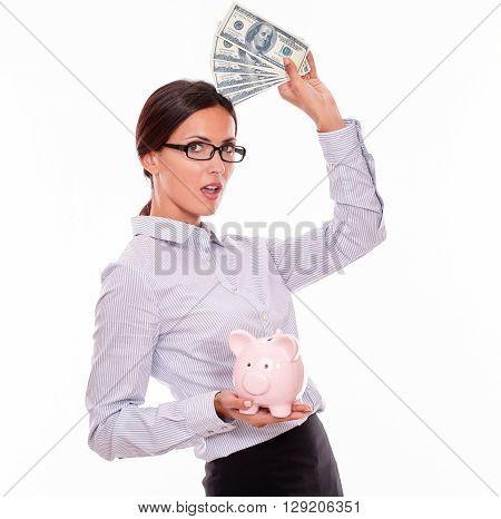 Businesswoman Holding Piggy Bank And Dollar Bills