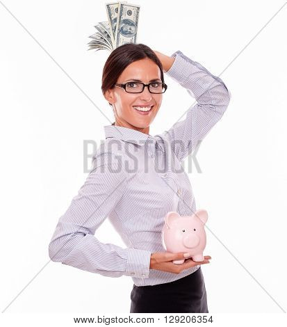 Businesswoman Holding Piggy Bank And Dollar Bills