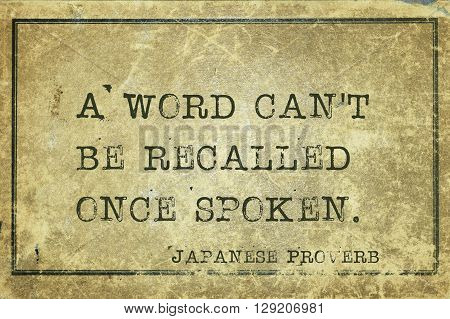 A word can't be recalled once spoken - ancient Japanese proverb printed on grunge vintage cardboard