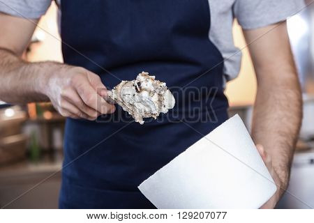 Waiter Putting Butterscotch Ice Cream In Cup