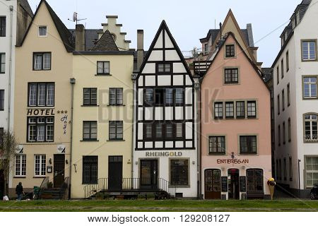 Cologne, Germany - May 16: These are old German houses on the waterfront of the left bank of the Rhine near Buttermark May 16, 2013 in Cologne, Germany.