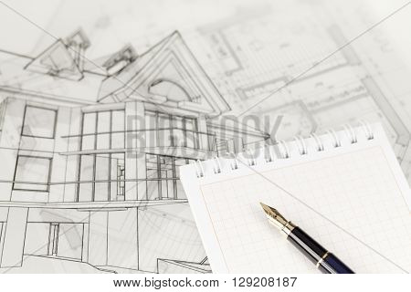 architecture blueprints & notepad and ink pen