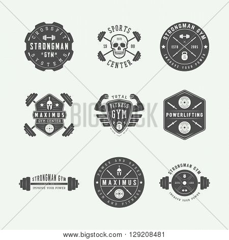 Set of gym logos labels and slogans in vintage style. Vector illustration