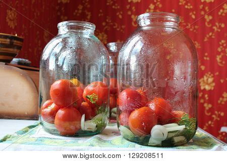 image of tomatoes in jars prepared for preservation