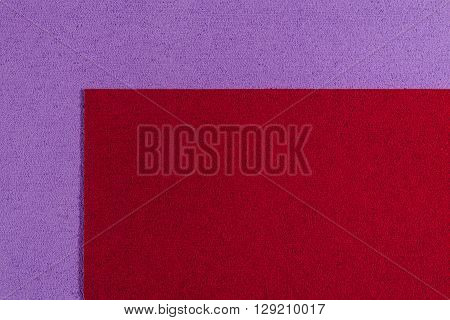 Eva foam ethylene vinyl acetate red surface on light purple sponge plush background