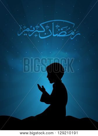 Silhouette of religious muslim boy reading Namaz (Islamic Prayer) with Arabic Calligraphy of text Ramadan Kareem on blue star light night background.
