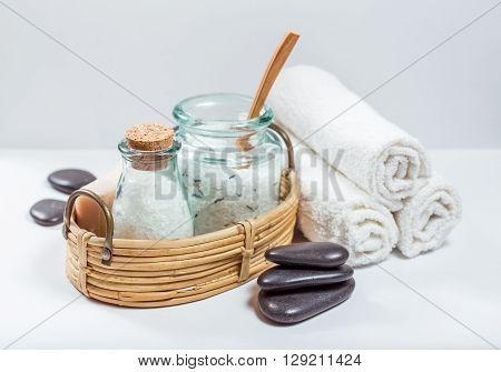 Spa and wellness setting with natural soap sea salt and towel.