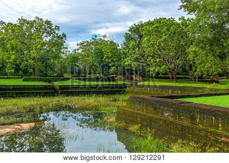 Sri Lanka Sigirija meadowsand verdant moss at the entrance of the Lion Rock archaeological site