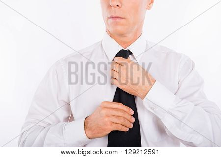 Close Up Photo Of Strict Businessman Fastening His Tie