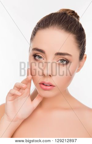 Portrait Of Pretty Woman With Perfect Skin Touching Her Face