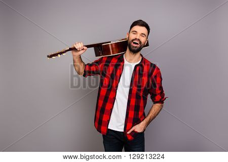 Cheerful Smiling Man Holding Guitar On His Shoulder