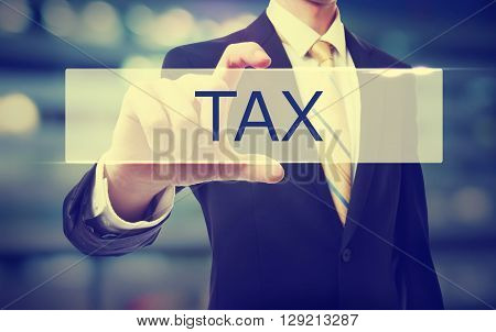 Business Man Holding Tax